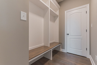 spacious closet with wooden shelves and floor